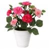 Planta artificial rosa poliester en maceta de terracota.